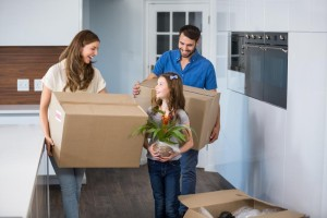 smiling-family-moving-house